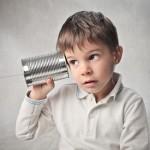 kid-playing-telephone-o